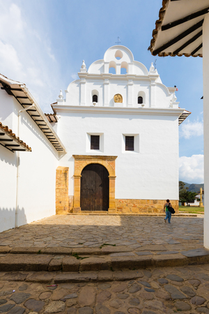 February 2018 This the main entrance of Our Lady of Carmen in in Villa de Leyva Colombia. This church is visited every day by many tourists intrigued by its white building. Stock Photo