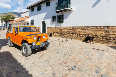 Villa de Leyva February 2018 This type of jeep supplied to the American army has been converted by the Colombians in the middle of work suitable for the streets of the cafe hills of the area. Editorial