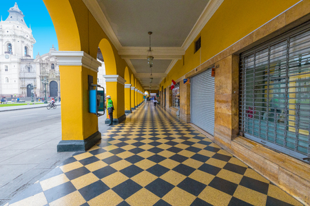 Lima Peru August 2018, under these arcades on the side of the main square of Lima, there are shops, bars and restaurants Editorial