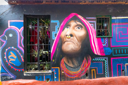 Bogota, Colombia March 31 This mural representing a native has been realized on a wall of one of the ancient districts of Bogota named la Candaelaria appreciated for its colonial style and street art. Shoot on March 31, 2019