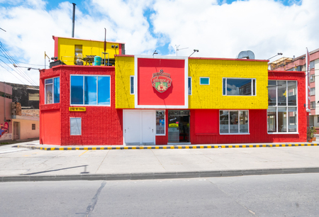 Bogota,  Colombia  July 7 Colorful building that houses a butcher in Normandia  district. Malls are not common in this part of the city so families activities are growing up. Shoot on March 06, 2019