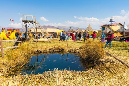 Titicaca Lake Peru, August 16 Floating islands made of straw allows locals to build home and schools living in the middle of the lake. Shoot on August 16, 2019 版權商用圖片