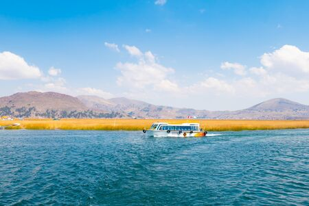 Titicaca Lake Peru, August 16 Tourists cross the lake on a straw boat during an excursion Shoot on August 16, 2019