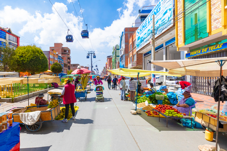La Paz Bolivia August 22, El Alto district known for its giant open air market can be reached in few minutes  by the cable car from the city center . Shoot on August 22, 2019 Stok Fotoğraf - 132892552