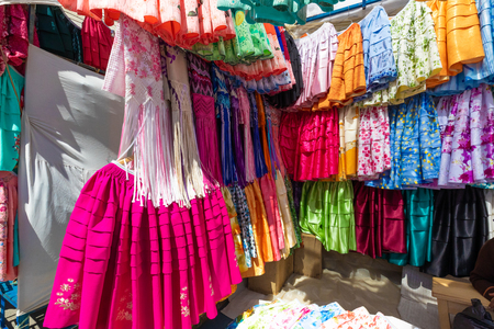 La Paz Bolivia August 22, Traditional skirts used by bolivian women  for sale in the big market called 16th July set up in Northern La Paz every Thursday. Shoot on August 22, 2019