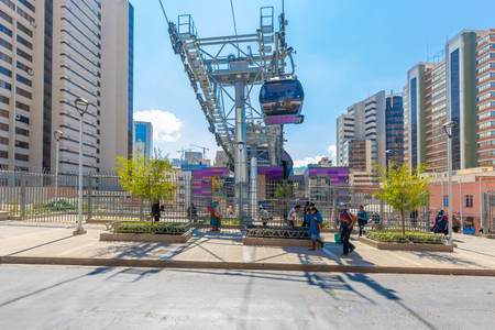 La Paz Bolivia August 26, people enter and leave the arrival station of cable car purple line. Shoot cable car on August 26, 2019