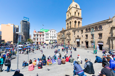 La Paz Bolivia August 26, people sitting on the steps of San Francisco square in the center of La Paz. Shoot on August 26, 2019