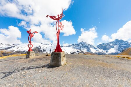 La Paz Bolivia September 11 Two red colored iron sculptures are found in a panoramic spot on the Bolivian andes. Shoot on September 2019
