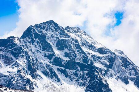 Bolivia white Cordillera snowy peak of Q ulini mountain in a sunny day Reklamní fotografie