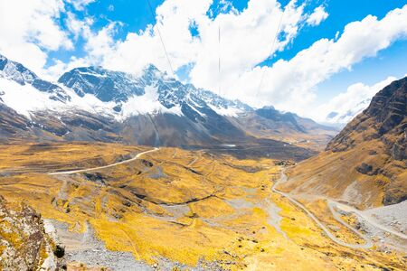 Bolivia valley between mountains of white cordillera in a sunny day