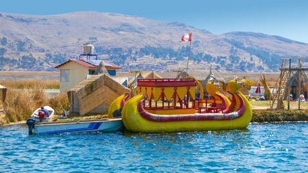 Lake Titicaca, Peru, August 16 a typical boat made of straw moored to a floating island of Lake Titicaca. Shoot on  August 16, 2019 Reklamní fotografie