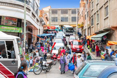 Sucre Bolivia October 19 Every day thousands of people, walking or driving, reach the farmer market in Northern Sucre the biggest market of the city. Shoot on October 19, 2019