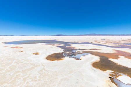 Bolivia Collecting pools of water  Salar of Uyuni in sunny day 스톡 콘텐츠