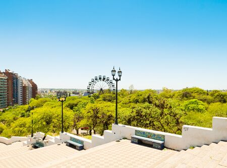 Cordoba Argentina December 9, panorama of Bonpland park characterized by the ferris wheel and the Andalusian style benches. Shoot on December 9 ,2019 Stock Photo