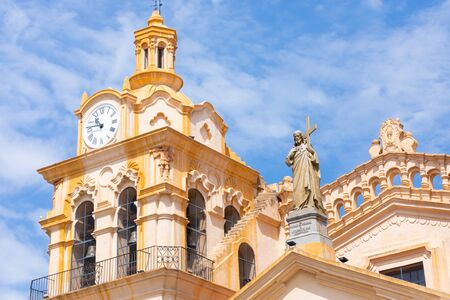 Cordoba Argentina December 9 clock tower and statue of Christ on the roofs of Cordoba s cathedral. Shoot on December 9, 2019. Stock Photo