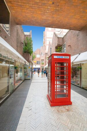 Rosario Argentina February 9 old English phone cabin in the pedestrian area of Garcia located in Northern Rosario full of shops, restaurants and cafes.  Shoot on February 9, 2020