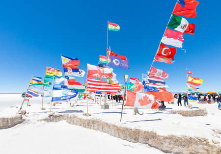 Uyuni Bolivia October 22  International flags in front of the sole hotel of Salar de Uyuni one of the stops during the tour.  Shoot on October 22, 2019 Editorial