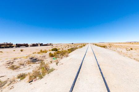 Uyuni Bolivia October 22 Train tracks in Uyuni desert are still used by trains transporting ores crossing the border with Atacama. Shoot on October 22, 2019