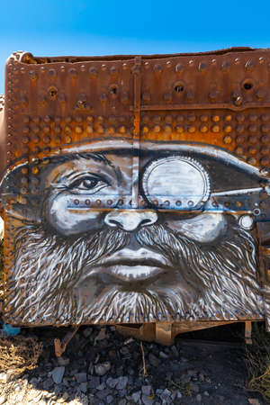Uyuni Bolivia October 22 face of man with beard drawn on old locomotive in the cemetery train collection of Uyuni.  Shoot on October 22, 2019 Editorial