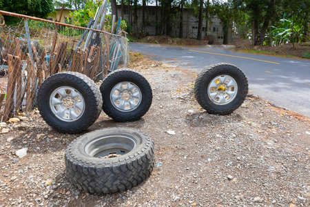 Panama Boquete July 6 these car wheels in the courtyard of a car mechanic represent the auto workshop sign. Shoot on July 6, 2020 Editorial