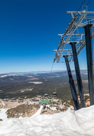 ski lift at Mammoth Mountain USA. Mammoth Lakes is a town in California's Sierra Nevada mountains. It's known for the Mammoth Mountain and June Mountain ski areas and nearby trails.