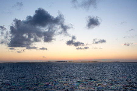 is over: Sunset over an island