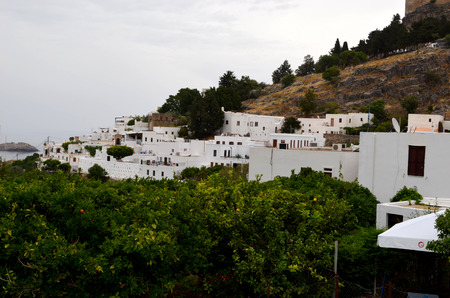View of the Greek town in Rhodes. Greek style can be seen immediately. White houses on the background of the sea.