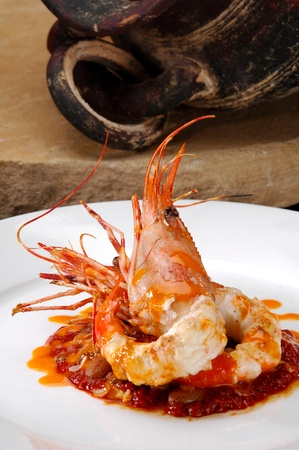 jumbo shrimp: Jumbo shrimp plated over a bed of red beans. Stock Photo