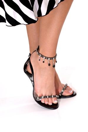 Female feet in fashionable black sandals Reklamní fotografie