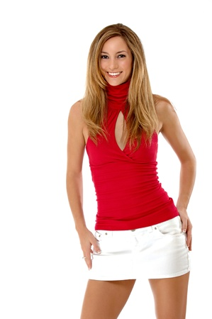 Three quarter length studio shot of a beautiful young woman isolated on white.  She is smiling and wearing a red shirt and white mini skirt. Stock Photo - 10599093