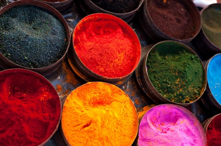 A market stall near Cuzco, Peru, South America. Tins of multicolored vegetable dyes and paints. Stock Photo