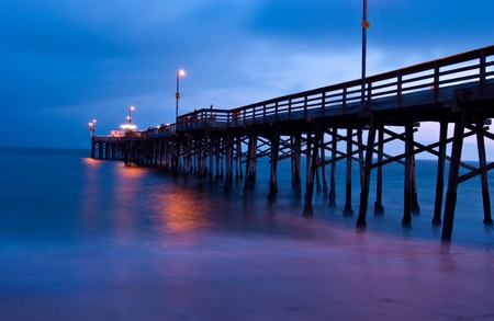 california beach: Sunset as seen from shore, looking out directly at Balboa Pier, Newport Beach, California. Stock Photo