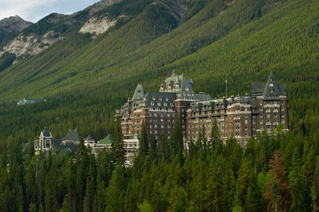 Luxurious Banff Springs Hotel in the Canadian Rockies, Alberta.  It looks like a castle among the green trees.