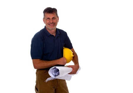 journeyman: A professional construction contractor worker is holding a hard hat and construction blue print plans, isolated on a white background.