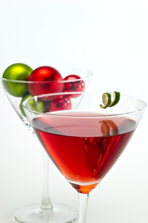 Red cranberry martini with festive Christmas ornaments in the background. Stock Photo - 10960197