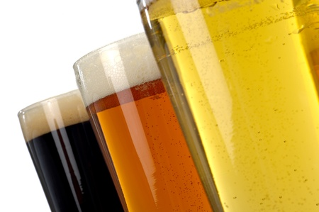 Beer decisions.  Colorful assortment of three beers shot on a white background. photo
