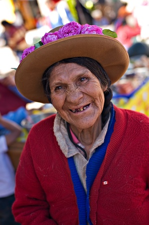 Pisac, Peru - August 17, 2008: Quechua woman smiles for the camera at a market in Pisac, Peru. Pisac Market in the Sacred Valley is a popular destination for tourism from all around the world.