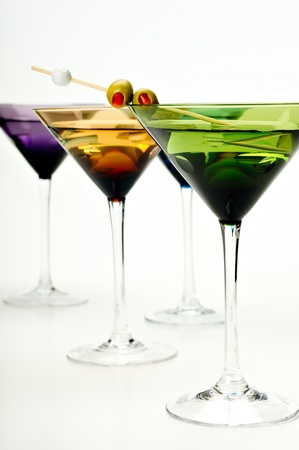Four colorful martini glasses shot in the studio on white. Stock Photo - 11091208