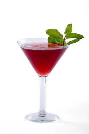 martini glass: Red cranberry martini with mint leaves garnish isolated on white