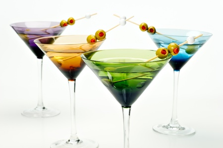 Four colorful martini glasses shot in the studio on white.