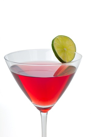 Red cranberry martini with a lime garnish isolated on white Stock Photo - 11091206