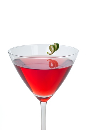 Red cranberry martini with a twist of lime garnish isolated on white Stock Photo - 11091205