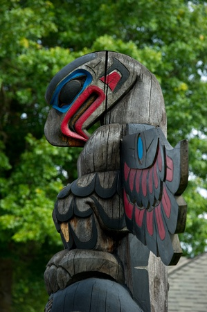 Detail of a totem pole located in Duncan, British Columbia.  Colorful representation of an Eagle.  photo