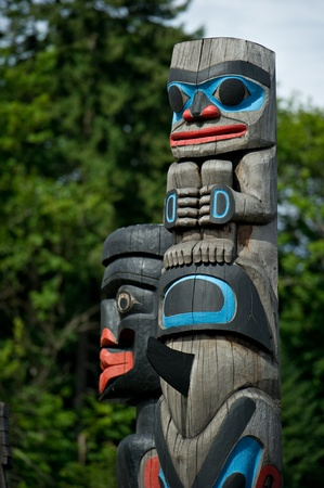 the totem pole: Detail of a totem pole located in Duncan, British Columbia.  Stock Photo