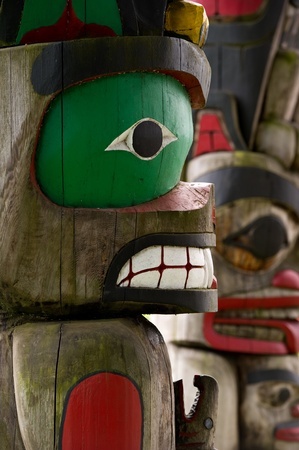 british  columbia: Detail of a totem pole located in Duncan, British Columbia.  Stock Photo