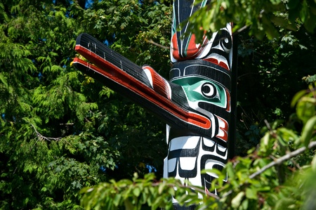 vancouver island: Detail of a totem pole located in Victoria, British Columbia.