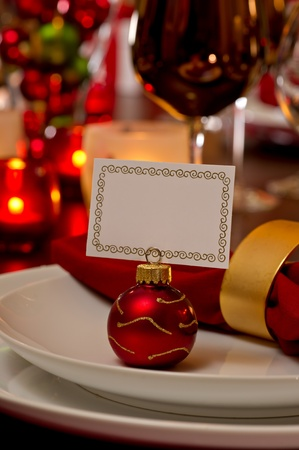 Elegant Christmas place setting place with ornament card holder on a white plate. Stock Photo - 11141995
