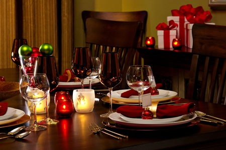 Elegant Dining Room Table decked out for Christmas Dinner. Stock Photo