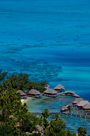 polynesia: View looking down over a beautiful turquoise lagoon of bungalows. Bora Bora Island, Tahiti, Society Islands, French Polynesia.