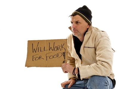Homeless man holding a will work for food sign isolated on white photo
